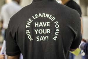 Prisoner wearing t-shirt promoting learner voice